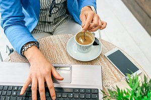 Businesswoman working during coffee