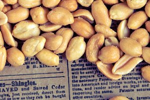 Nuts with salt on a newspaper