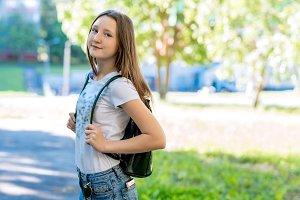 Girl schoolgirl in summer in the