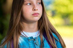 Portrait of a teenage girl, in