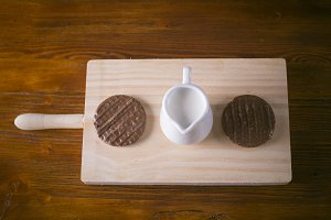 Chocolate, milk and cookies on wood