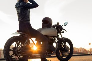 Biker girl on caferacer motorcycle.