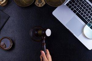 Hand holding law gavel
