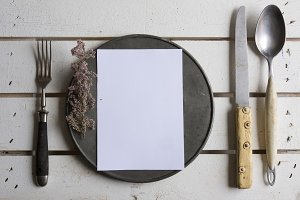 Rustic place setting menu on old whi