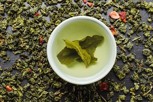 Bowl with leaf green oolong tea