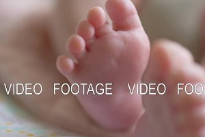Little bare feet of the baby