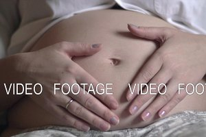 Pregnant woman touching and stroking