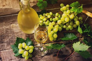 Wine background. White wine in glass