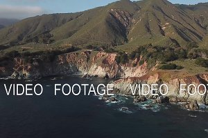 aerial , mountains on the shore of