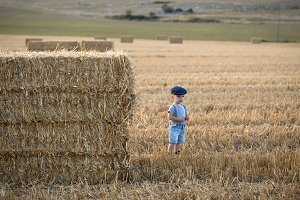 cute little boy on a haystack