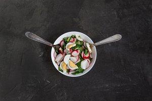 Vegetable vegan salad of ramson, rad
