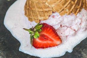 Strawberry ice cream in a waffle con