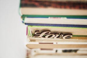 on a stack of old books wooden word
