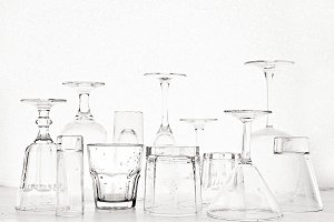 Glass goblets of different shapes on