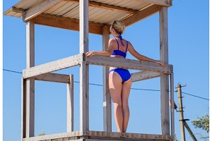 A woman in a blue bathing suit on