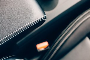Detail of a car armrest in a leather