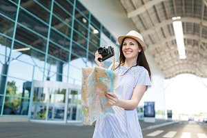 Young smiling traveler tourist woman