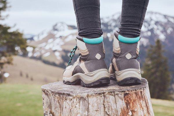 Hiking boots on stump