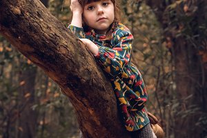 CHILD IN THE TREE. autumn