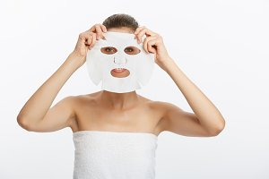 Young girl with facial mask looking