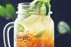 Ice black tea in a glass jar