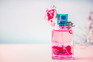 Pink Bottle of perfume with flowers