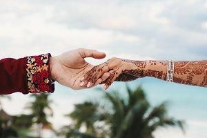 Groom holds tender hand of Hindu