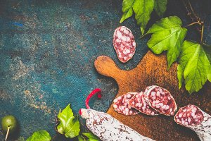 Salami sausage on rustic table