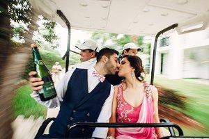 Cheerful Hindu wedding couple rides
