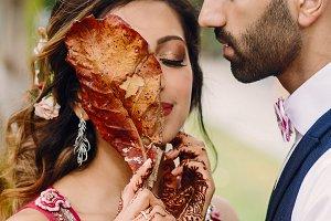 Hindu bride holds autumn leaf