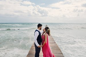 Wind blows bride's pink sari