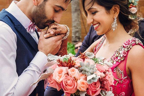 People Stock Photos: IvashStudio - Happy Hindu groom holds tender bride