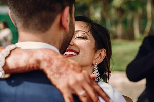 Indian bride and groom hugs