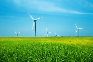 Wind turbines on green field