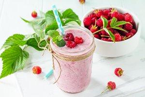 Raspberry milkshake or smoothie on a