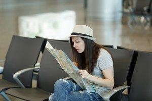 Young concerned traveler tourist wom