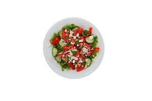 Shopska salad in a white plate isola