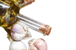 garlic, olive oil in a bottle isolat