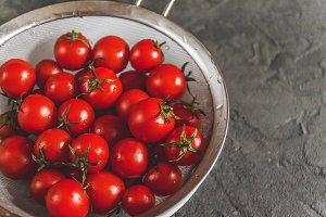 raw whole washed cherry tomatoes in