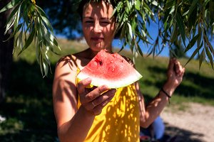 Woman eat watermelon
