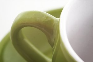 A green cup handle for tea or coffee