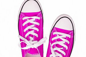 pair of sneakers-colored youth runni