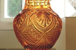 A large brown crystal vase