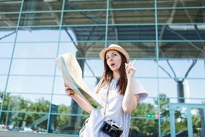 Young traveler tourist woman with re