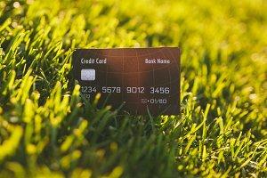 Close up credit bank black card on v