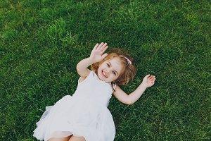 Joyful little cute child baby girl i