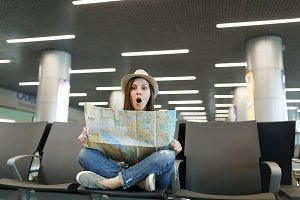Young shocked traveler tourist woman