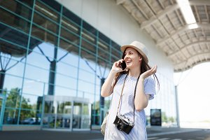 Smiling traveler tourist woman with