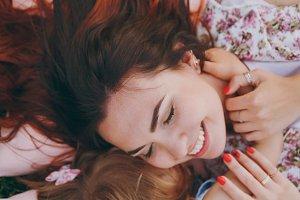 Joyful woman and little cute child b