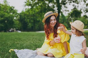 Smiling woman in yellow dress play o